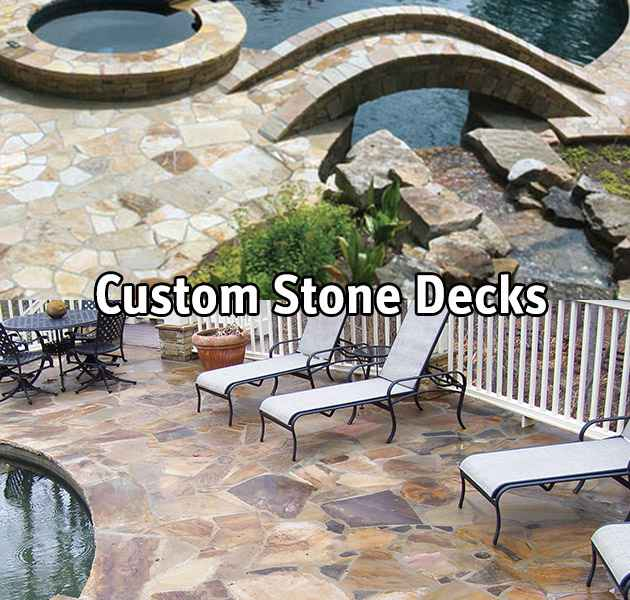 Custom stone decks around a swimming pool.